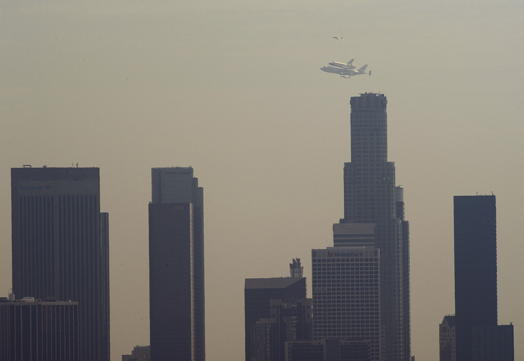 The Space Shuttle Endeavor is ferried past the tallest building in Los Angeles — and west of the Mississippi. The U.S. Bank Tower is being sold to developers from Singapore.