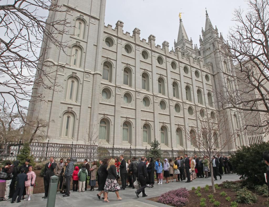 Mormon faithful line up outside the historic Salt Lake Temple in Salt Lake City, Utah.