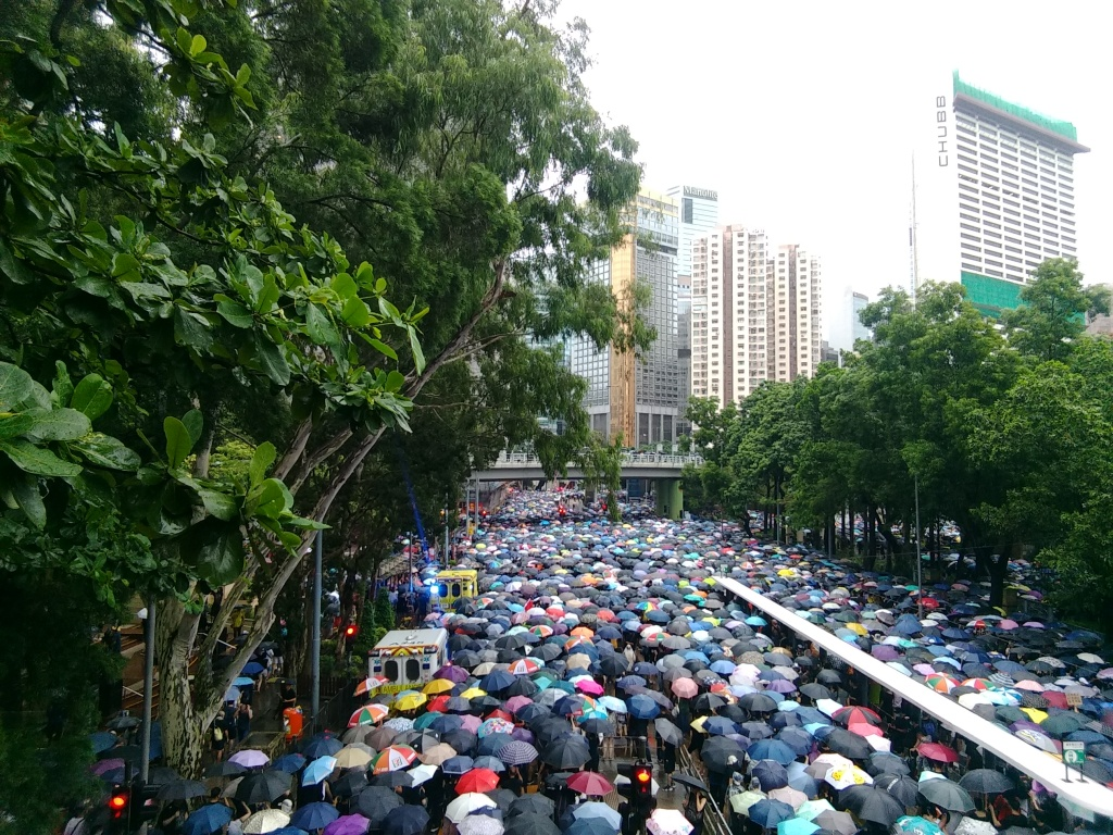 Protesters marching peacefully along Victoria Park in Hong Kong