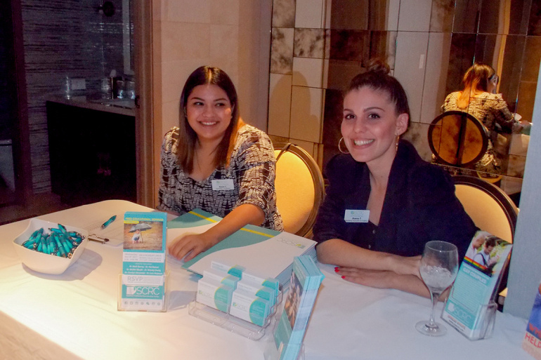 "Two Southern California Reproductive Center employees register attendees at an ""egg social"" at the presidential suite of the Viceroy L'Ermitage in Beverly Hills."