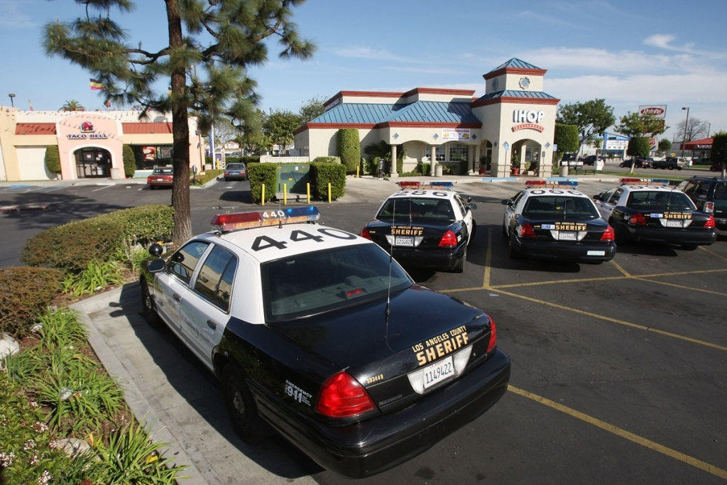 File: Los Angeles County Sheriff's cars are ever-present at businesses and malls throughout the city March 3, 2009 in Compton, California.