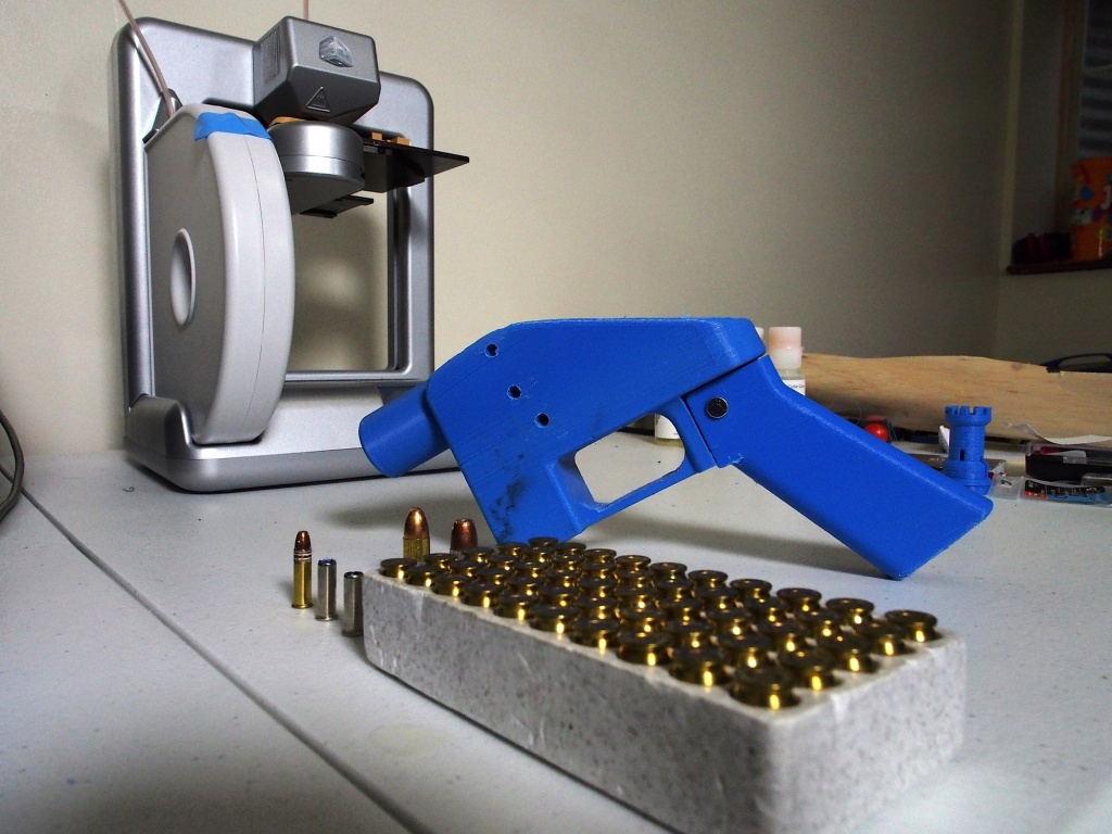 A Liberator pistol appears on July 11, 2013 next to the 3D printer on which its components were made.