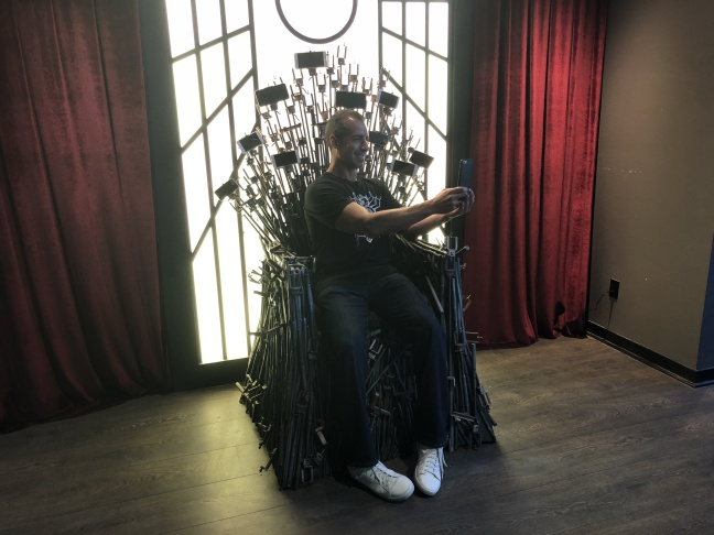 A Martinez takes a selfie on the Selfie Throne at the Museum of Selfies.