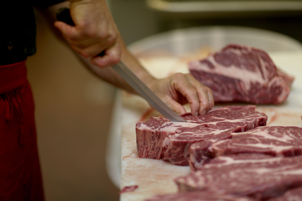 Robert Laurenzo prepares cuts of beef at Laurenzo's Italian Center on January 13, 2014 in North Miami Beach, Florida.