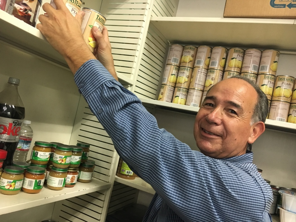 Andy Molina runs a food pantry at the Southeast Churches Service Center in Huntington Park. He said he's seen a rise in homeless in the area, including military veterans, who come daily to his pantry seeking help.