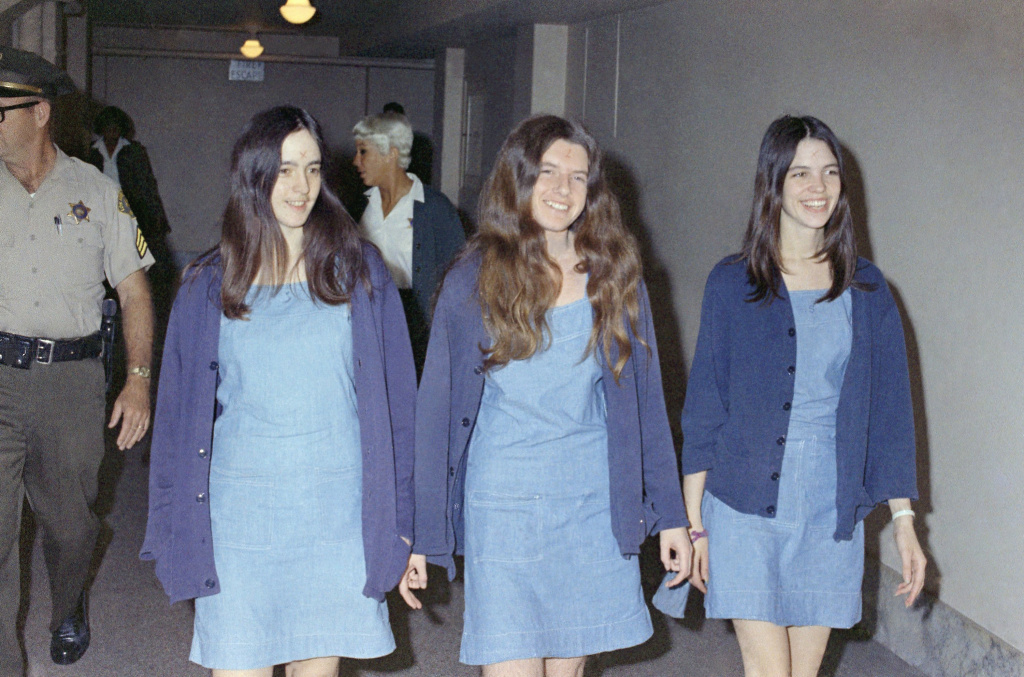 Susan Atkins (left), Patricia Krenwinkel and Leslie Van Houten walk to court to appear for their roles in the 1969 cult killings of seven people in the Tate-LaBianca murders. All three, plus Charles Manson, were sentenced to death — though those sentences were later commuted to life in prison.
