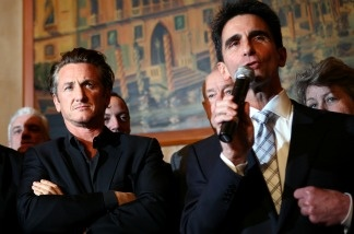 Academy award winning actor Sean Penn (left) looks on as California Sen. Mark Leno (right) speaks during a press conference announcing legislation to create a Harvey Milk Day in California on March 3, 2009 in San Francisco to recognize the efforts of the slain gay rights activist.