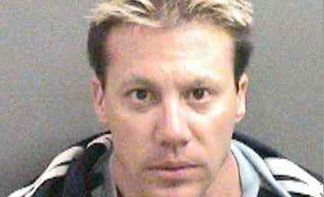 Booking photo of Derrick Frisco taken July 23, 2010 courtesy of the Orange County Sheriff's Department