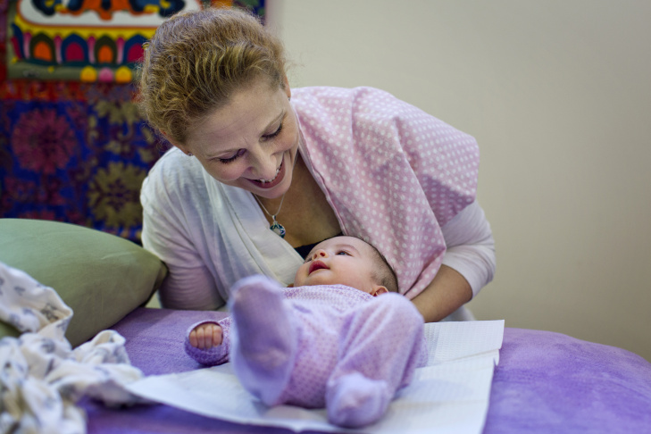 Dr. Natalie Nevins visits a newborn in her Hollywood wellness center.