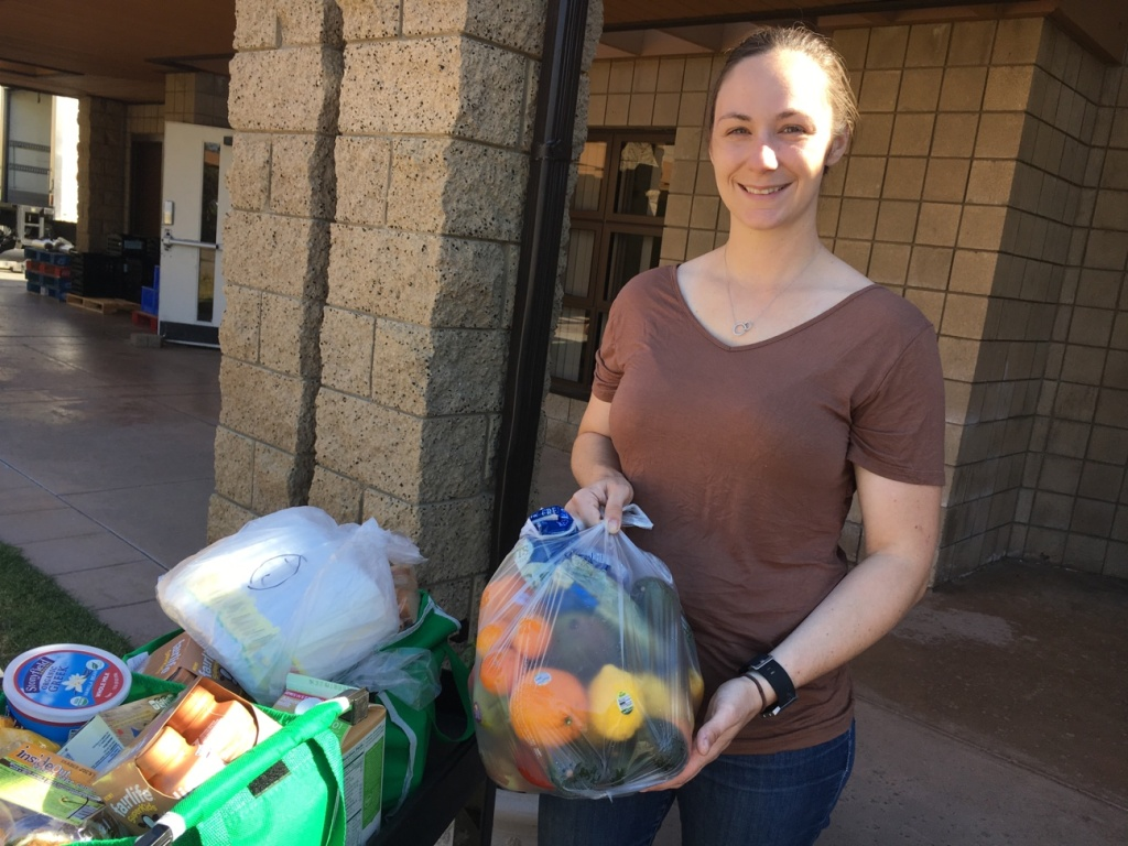 Kara Dethlefsen, 27, an active duty Marine, attends the monthly food pantry at Camp Pendleton. Her husband is also a Marine. She said the food assistance helps them get ready for his transition back to civilian life and with the raising of their 4-month-old daughter.