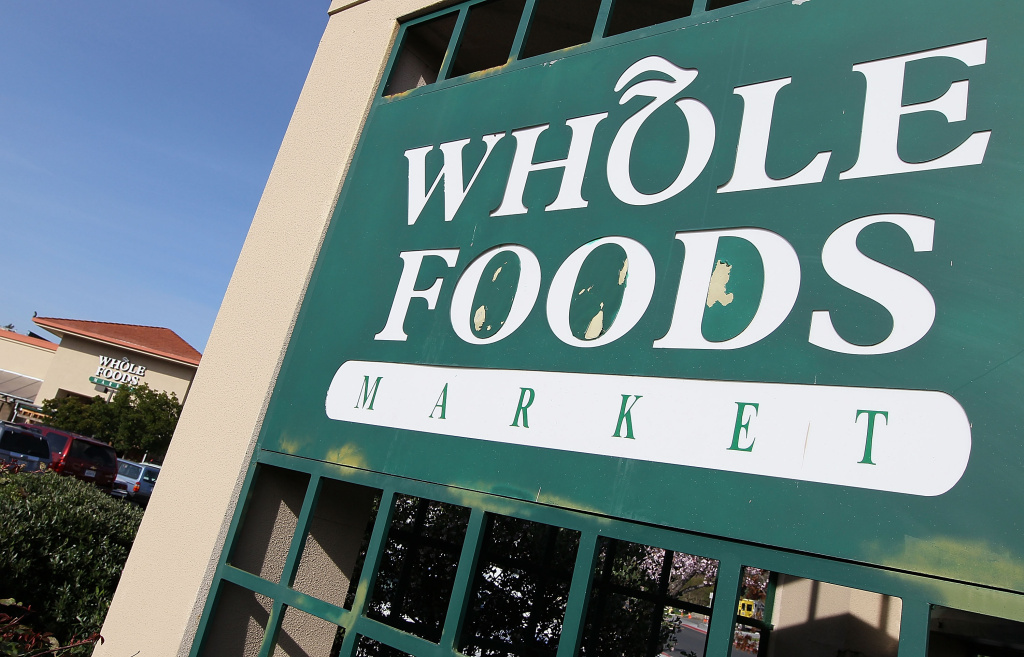 A sign is posted in front of a Whole Foods store February 17, 2010 in San Rafael, California.