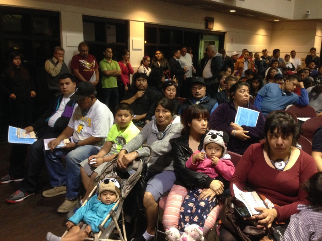 Immigrants without legal status attend a hearing on getting driver's licenses at the Bell Community Center.
