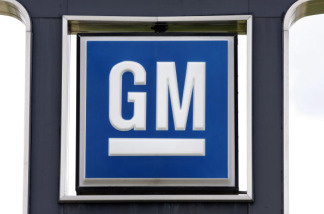 A GM logo is seen at a General Motors used car dealership at the Troy Motor Mall August 17, 2010 in Troy, Michigan.