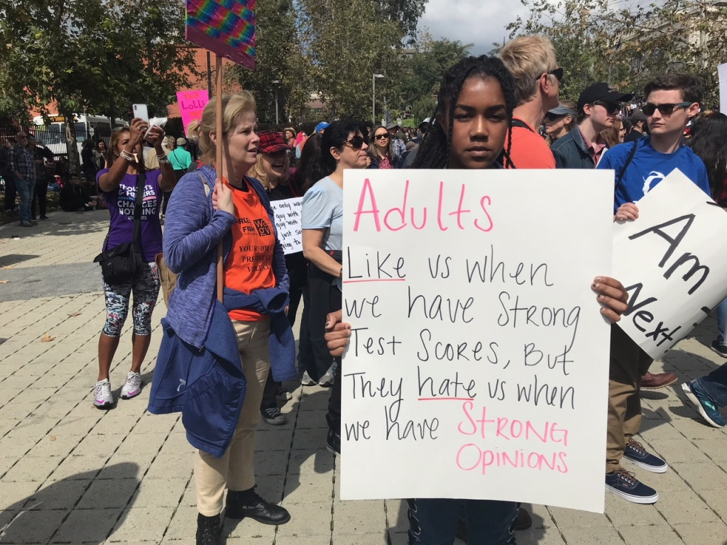 Nyasha Ezekiel, a senior at Palisades High Schools, holds up her sign at the March for Our Lives rally in downtown Los Angeles.