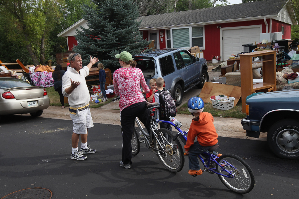 John Holzhauer speaks to a neighbor at his home on September 15, 2011 in Centennial, Colorado.