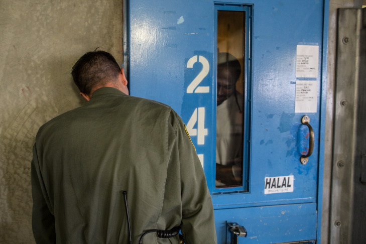 An officer speaks with an inmate as he makes his way around a general population wing of the prison.