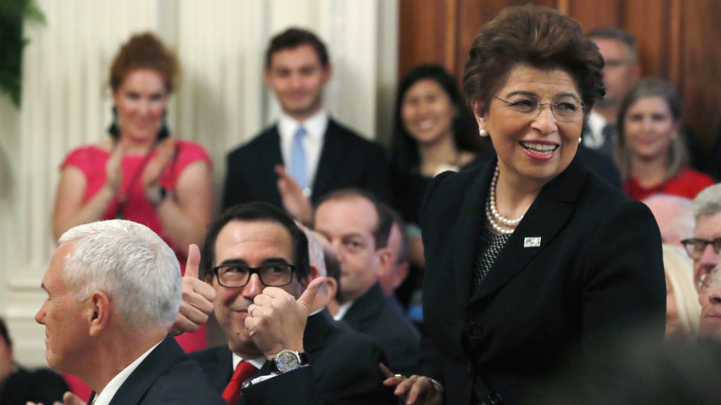 Treasury Secretary Steve Mnuchin (left) gives two thumbs up for U.S. Treasurer Jovita Carranza in 2018. On Thursday, President Trump announced that he will nominate Carranza to lead the Small Business Administration.