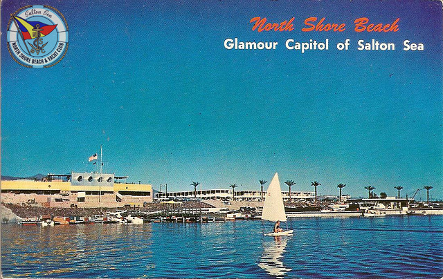 Historic postcard of the Salton Sea, with the yacht club to the left.