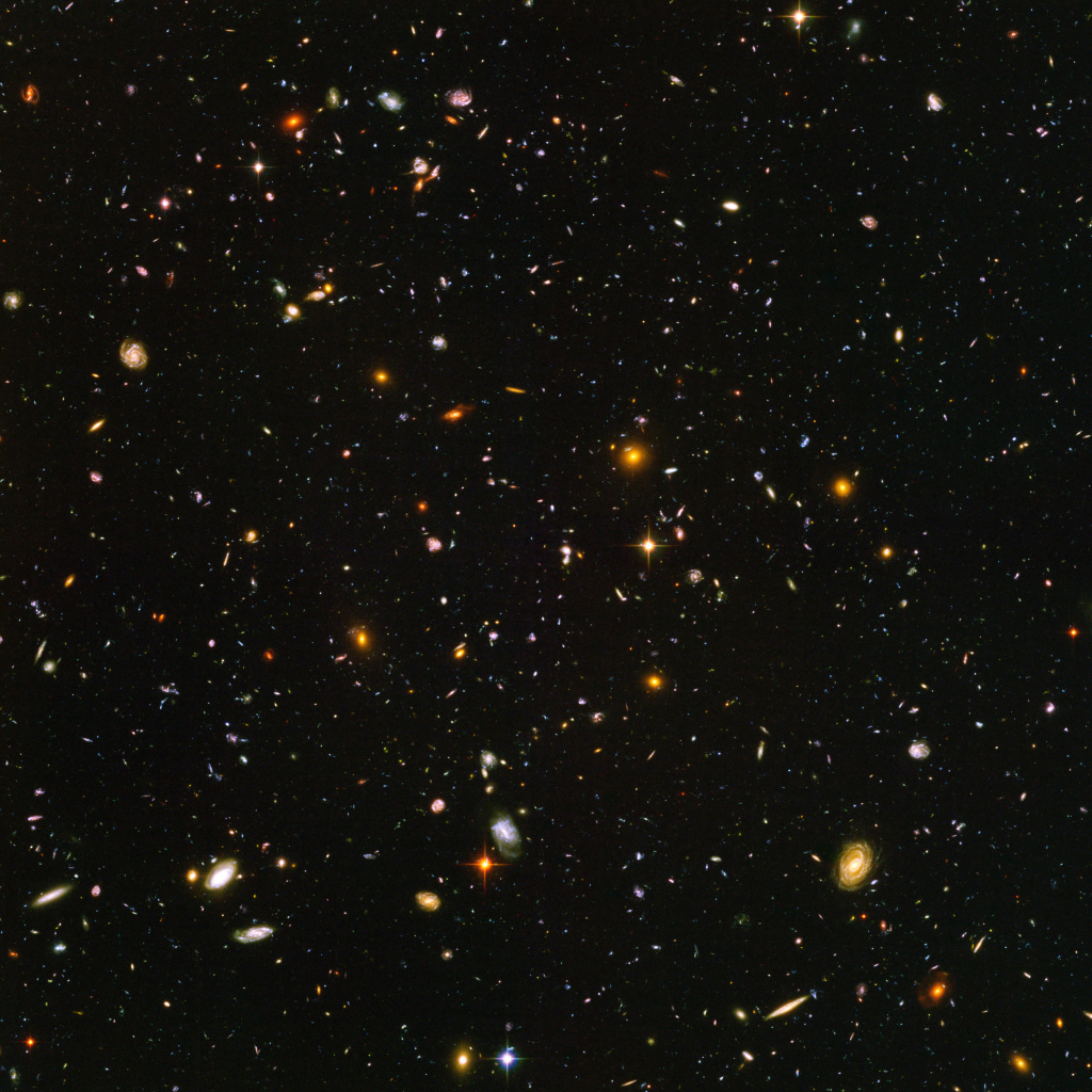 A view of nearly 10,000 galaxies are seen in a Hubble Telescope composite photograph. The Hubble Ultra Deep Field (HUDF) photograph is a composite of a million one-second exposures and reveals galaxies from the time shortly after the big bang.