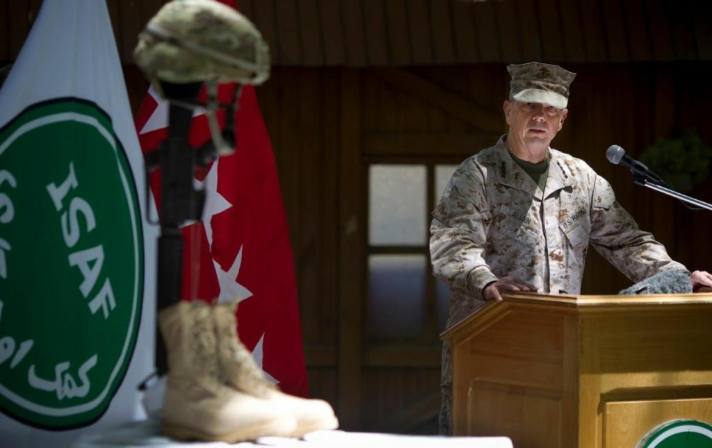 Gen. John Allen, the top U.S. commander in Afghanistan, observes Memorial Day by reading a letter written by an American soldier to his family before he died earlier this year, at the ISAF headquarters in Kabul, Afghanistan, Monday, May 28, 2012.
