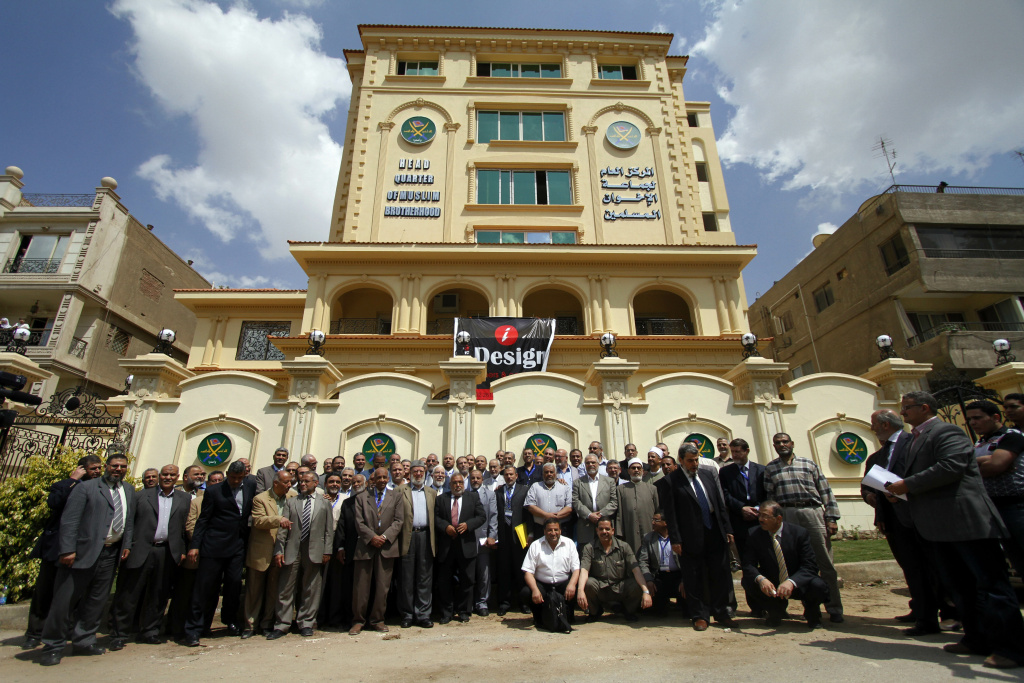 In this April 30, 2011 file photo, Egyptian Muslim brotherhood Shura council members gather to be photographed outside the new Muslim Brotherhood headquarters in Cairo, Egypt. An Egyptian court on Monday, Sept. 23, 2013 ordered the Muslim Brotherhood to be banned and its assets confiscated in a dramatic escalation of a crackdown by the military-backed government against supporters of the ousted Islamist president Mohammed Morsi.