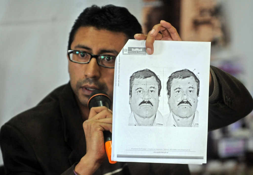 Guatemalan migration director Carlos Pac shows a picture of Mexican drug trafficker Joaquin