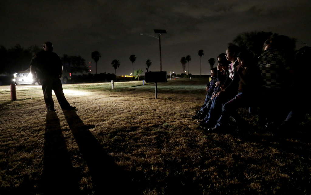 A group of immigrants from Honduras and El Salvador, who crossed the U.S.-Mexico border illegally, are stopped by Border Patrol in Granjeno, Texas.