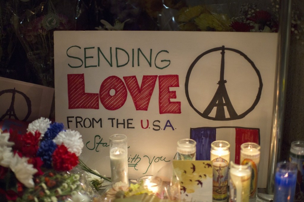 A sign sends a message of love from the Untied States to France at a makeshift memorial outside the French Consulate  in Los Angeles, California on November 14, 2015, one day after the Paris terrorist attacks.  Stirring renditions of