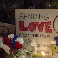 "A sign sends a message of love from the Untied States to France at a makeshift memorial outside the French Consulate  in Los Angeles, California on November 14, 2015, one day after the Paris terrorist attacks.  Stirring renditions of ""La Marseillaise"" rang out from Dublin to New York as global landmarks were bathed in the French colors and thousands marched in solidarity with Paris after attacks that left at least 129 dead."
