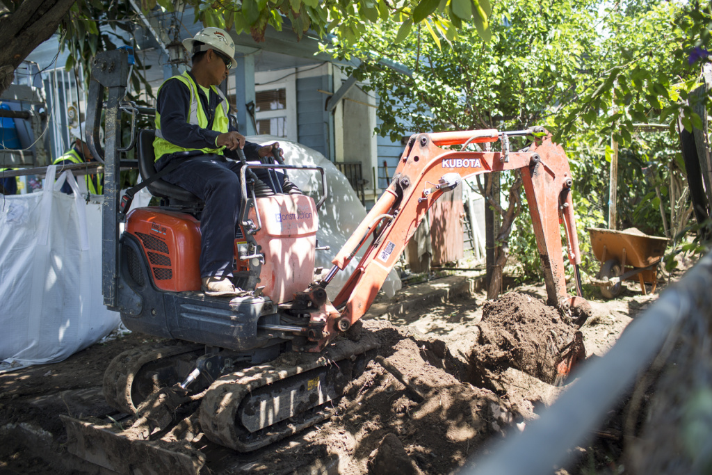 A soil removal, part of the Exide cleanup through the California Department of Toxic Substances Control, takes place at an East Los Angeles home on Wednesday, April 20, 2016.