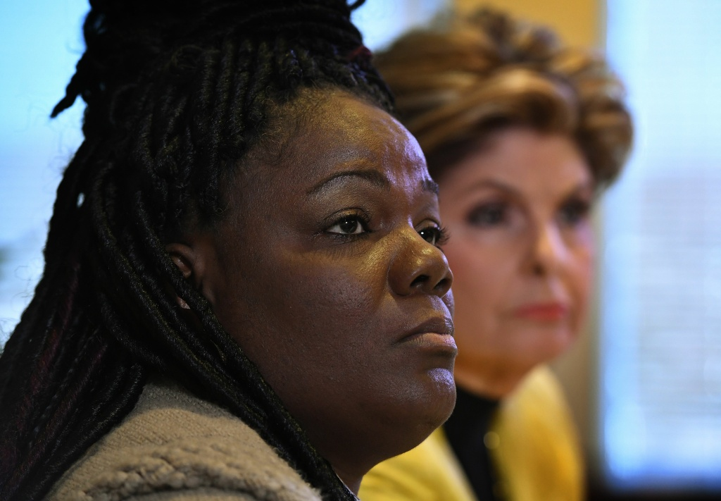 Essie Grundy (L) sits beside attorney Gloria Allred as they announce their race discrimination lawsuit against retail giant Walmart in Los Angeles, California on January 26, 2018.
