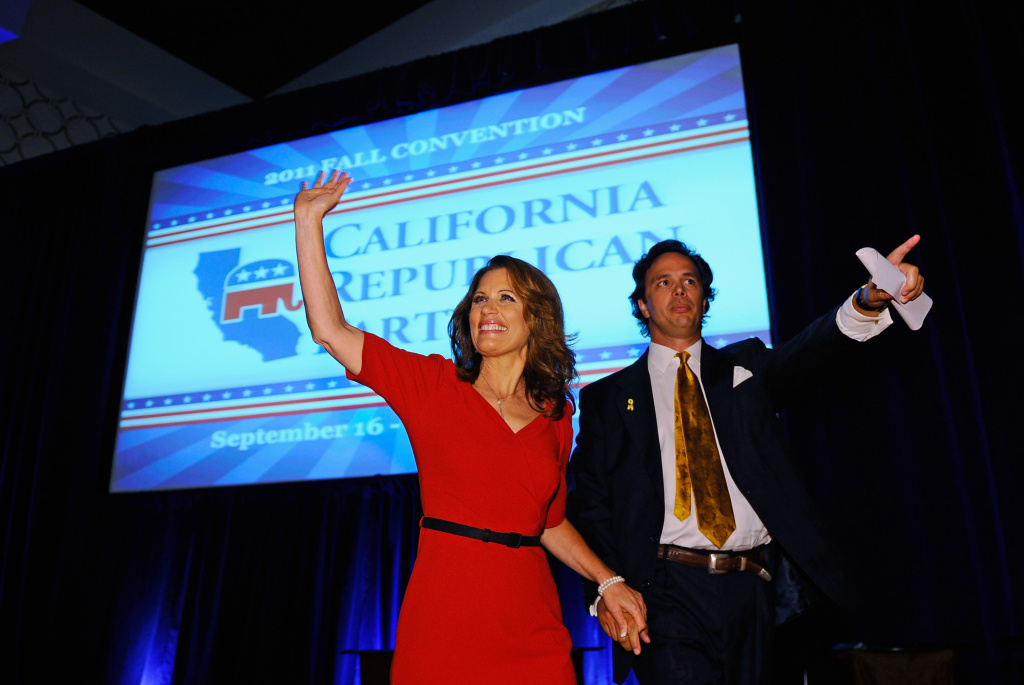 Republican presidential candidate Michele Bachmann (R-MN), escorted by California Republican Party chairman Tom Del Beccaro, arrives to deliver a speech to the California Republican Party Convention banquet September 16, 2011 in Los Angeles, California.