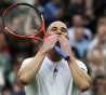 Andre Agassi blows kisses to the fans following the Men's Singles match against Tim Henman during the 'Centre Court Celebration' at Wimbledon on May 17, 2009 in London, England