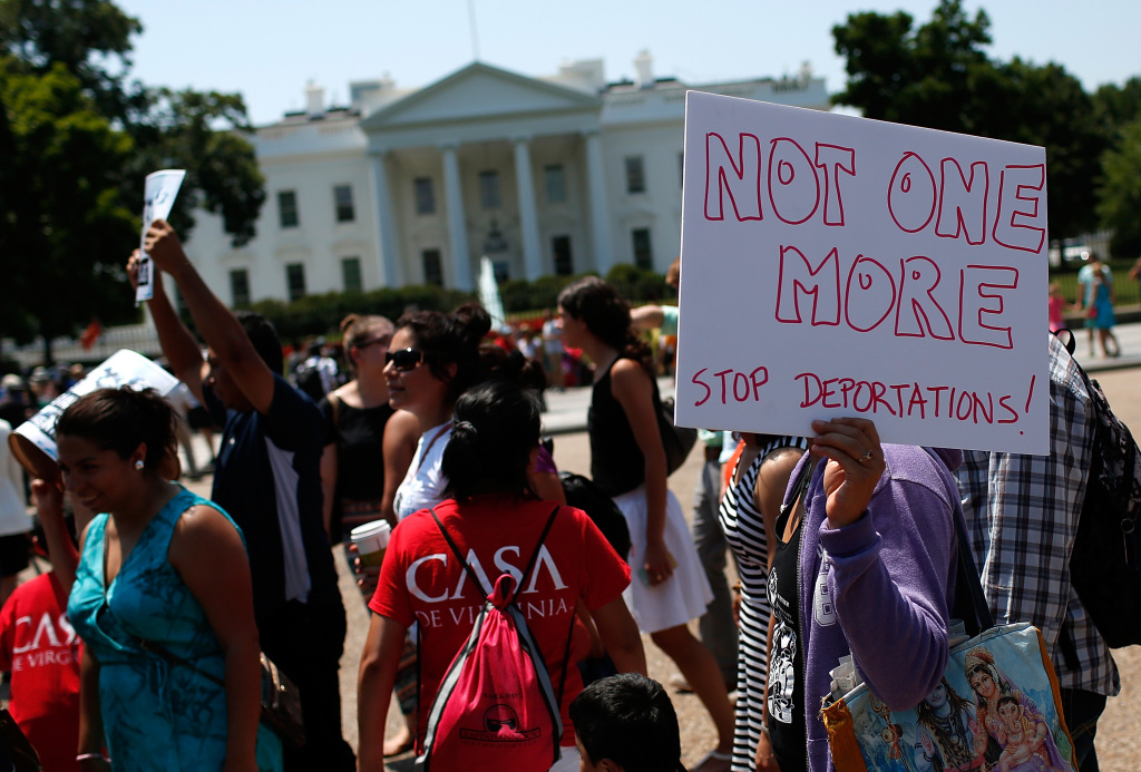WASHINGTON, DC - JULY 07:  Immigration reform protesters march during an immigration rally July 7, 2014 in Washington, DC. Participants condemned