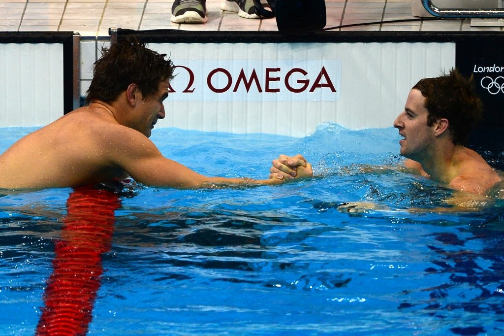 Australia's James Magnussen (left) congratulates US swimmer Nathan Adrian (right) after the men's 100m freestyle final swimming event.