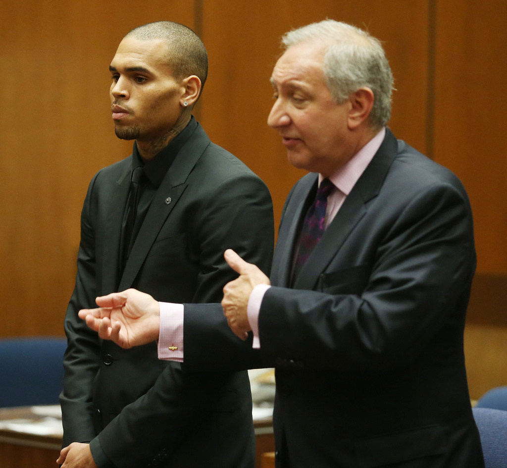 Recording artist Chris Brown (L) and his attorney Mark Geragos appear in Los Angeles court on November 20, 2013 in Los Angeles, California. Brown was ordered to 90 days at an inpatient center, random drug testing and 24 hours of weekly community service. Brown was arrested last month for misdemeanor assault in Washington, DC and was already on probation for a felony domestic violence charge after a 2009 incident with then-girlfriend Rihanna.