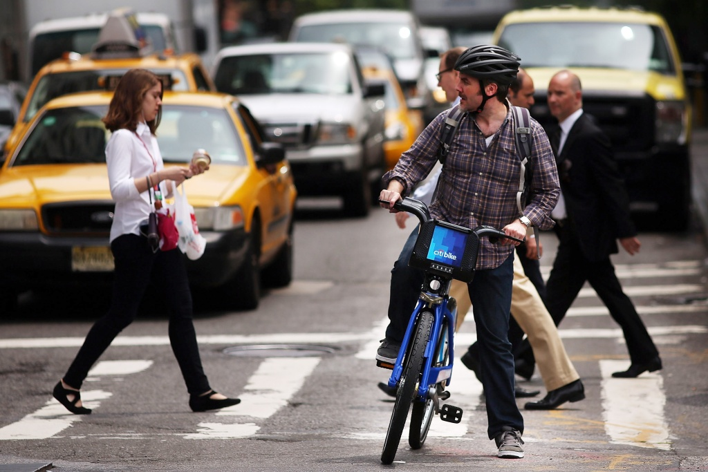 A man rides a Citi Bike in New York City. Citi Bike, the bike sharing program that launched over the Memorial Day weekend in New York, provides 6,000 bikes. Is it a good idea for Los Angeles to have the same kind of bike sharing program?