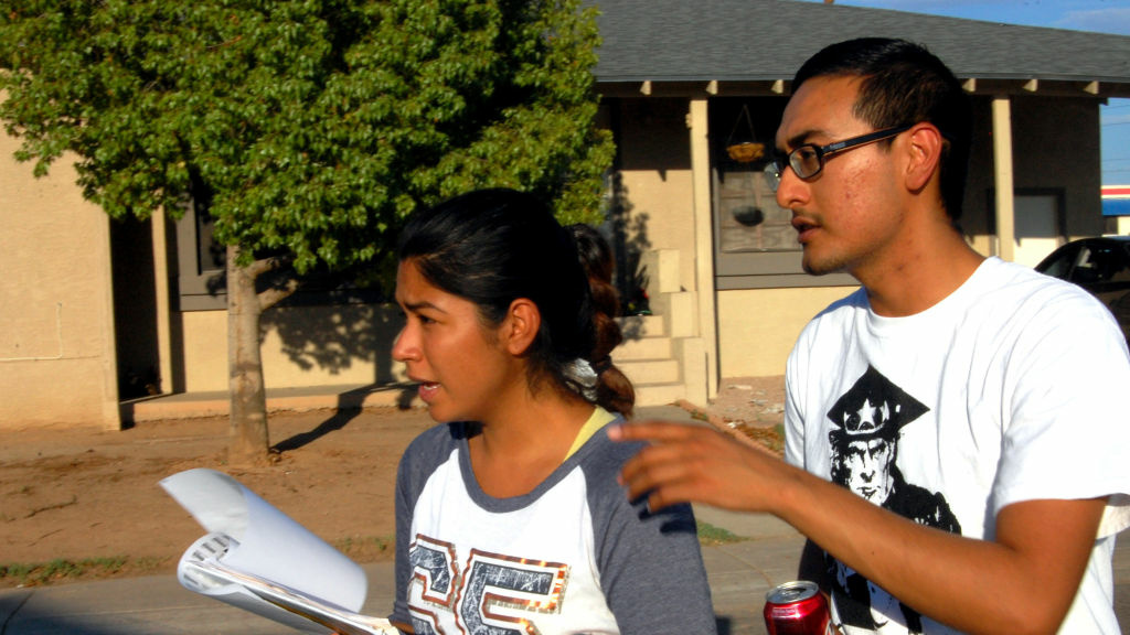 Maxima Guerrero and Daniel Rodriguez canvass for votes in Phoenix. Rodriguez moved to the U.S. with his mother when he was a child, and is undocumented.