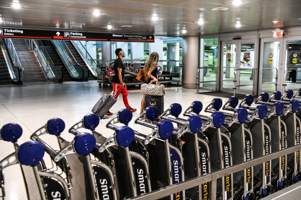 Travelers arrive at Miami International Airport (MIA) ahead of the long holiday week-end of Memorial Day in Miami on May 26, 2021.