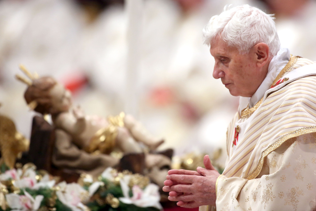 Pope Benedict XVI walks in front a manger as he attends the Christmas night mass at the St. Peter's Basilica on Dec. 24, 2012 in Vatican City, Vatican.