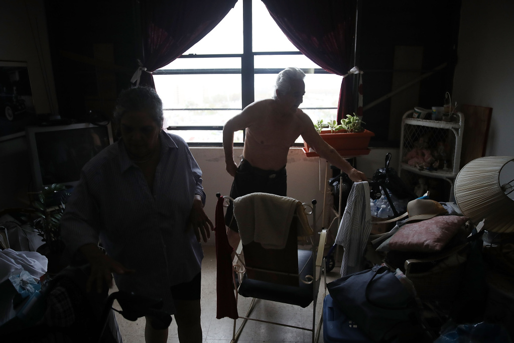 Nilsa and Carlo Gonzalez live in their dark apartment as they and other residents of the 62-and-over Moradas Las Teresas's Uno and Dos condo units deal with no electricity in the aftermath of Hurricane Maria on September 30, 2017 in San Juan, Puerto Rico.