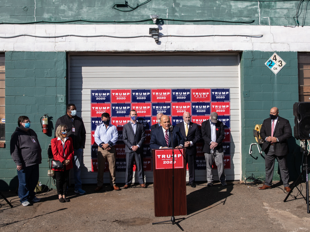 Rudy Giuliani, President Trump's attorney, speaks at a press conference held in the back parking lot of Four Seasons Total Landscaping on Saturday in Philadelphia.