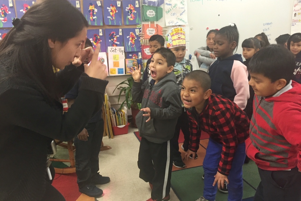 Teacher Maria Ortega uses an arts integration technique with her kindergarteners to help reinforce vocabulary about bears.