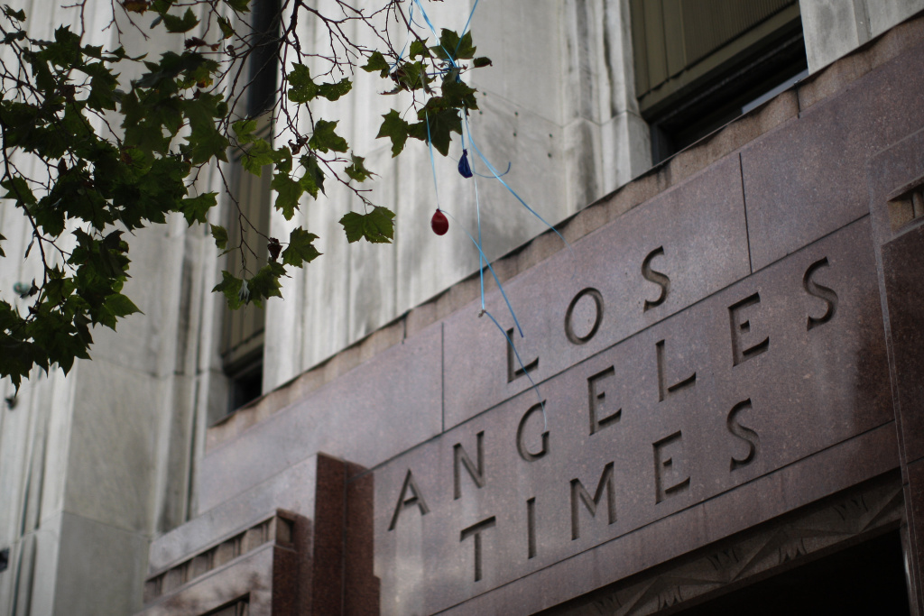 Deflated balloons hang from a tree outside the entrance to the Los Angeles Times building on July 10, 2013 in Los Angeles, California.