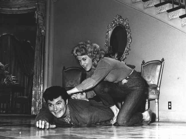 From left, actors Irene Ryan, Donna Douglas, and Buddy Ebsen appear in a scene from the television series