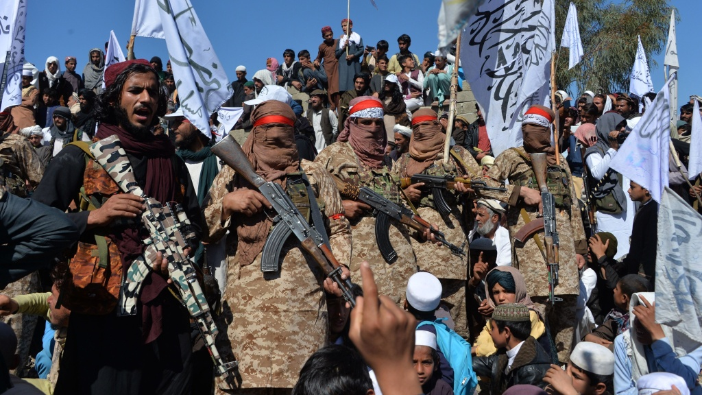 Militants linked with the Afghan Taliban gather Monday for a ceremony in Laghman province, celebrating the agreement the group signed with the U.S. over the weekend. Since the deal was announced, the Taliban have resumed attacks in Afghanistan.