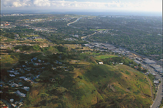 Aerial of Baldwin Hills Scenic Overlook with the Ballona Creek winding through Culver City to the Ballona Wetlands and emptying into the Pacific Ocean at Marina Del Rey.
