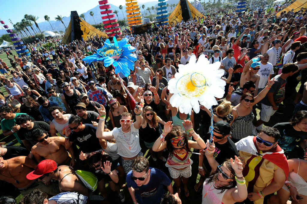 Coachella music fans dance during Day 2 of the 2012 Coachella Valley Music & Arts Festival held at the Empire Polo Club on April 14, 2012 in Indio, California.