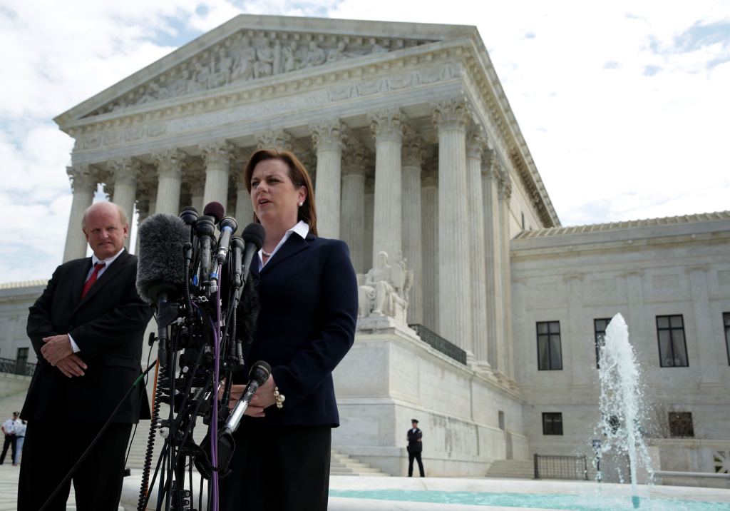Susan B. Anthony List President Marjorie Dannenfelser (R) speaks to members of the media in front of the U.S. Supreme Court as lead counsel Michael Carvin (L) looks on April 22, 2014 in Washington, DC.