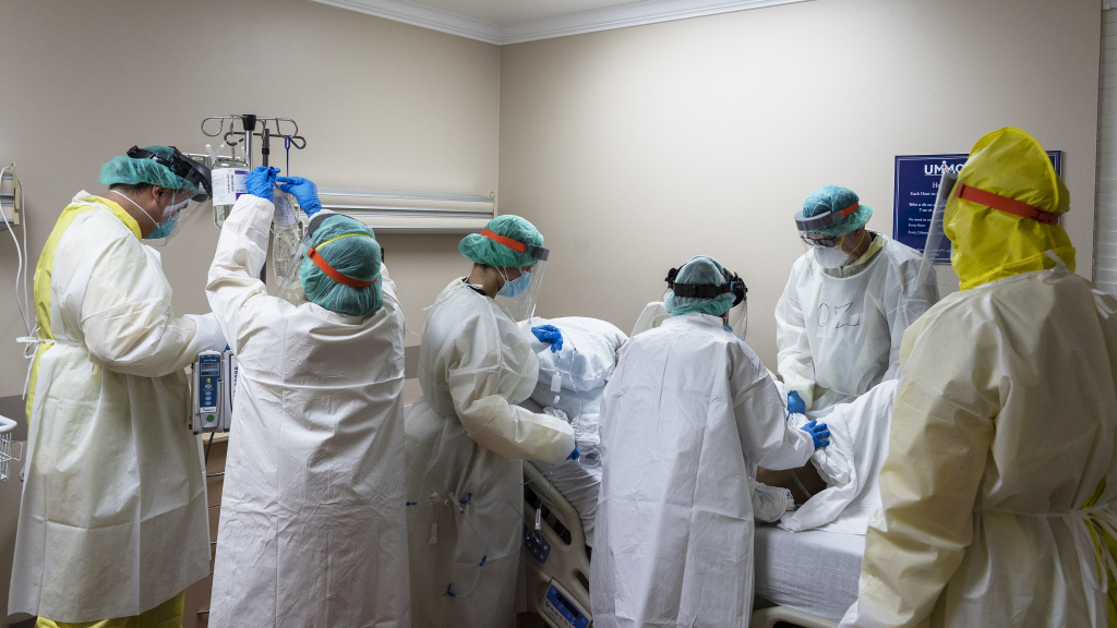 Members of the medical staff treat a patient in the COVID-19 intensive care unit at the United Memorial Medical Center on July 2, in Houston, Texas. More than 700 military health professionals are being sent to regions with spikes in coronavirus cases, including Houston.